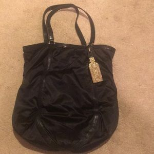 Henri Bendel tote with gold plated store tag